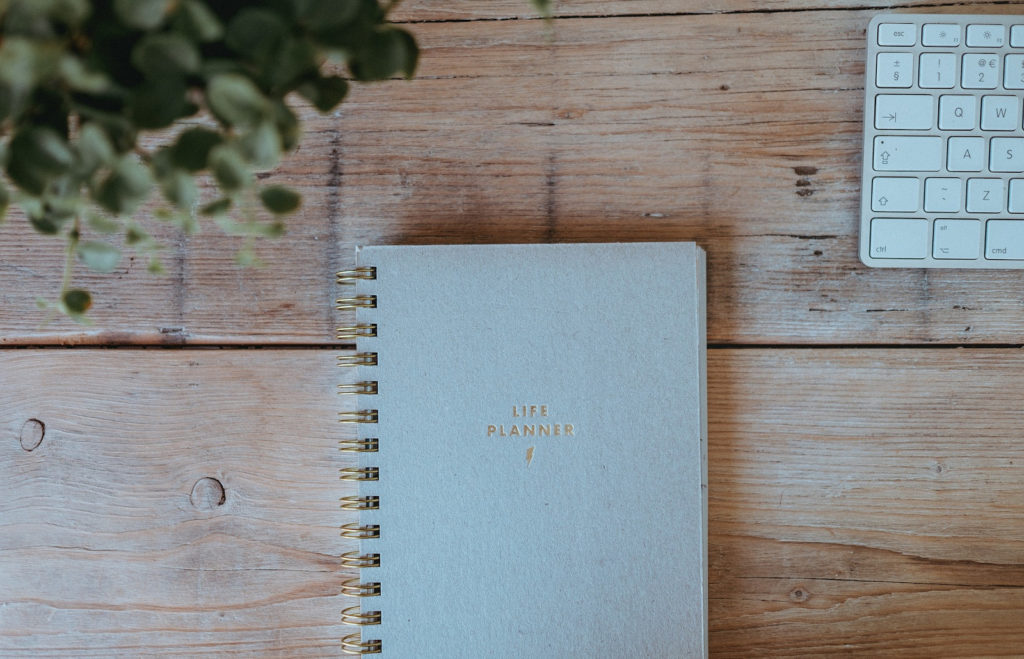 Life Planner on Wooden Table