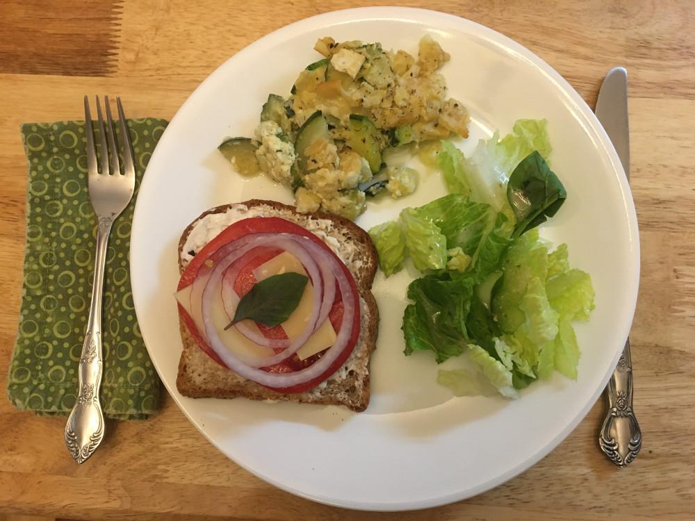 simple supper of zucchini casserole, tomato sandwich and salad