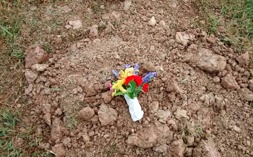flowers on grave of stillborn infant