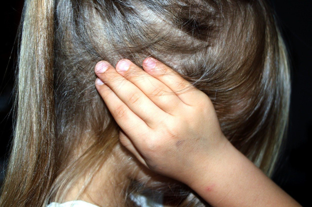 child covering ears, learn to prevent meltdowns by supporting self-regulation