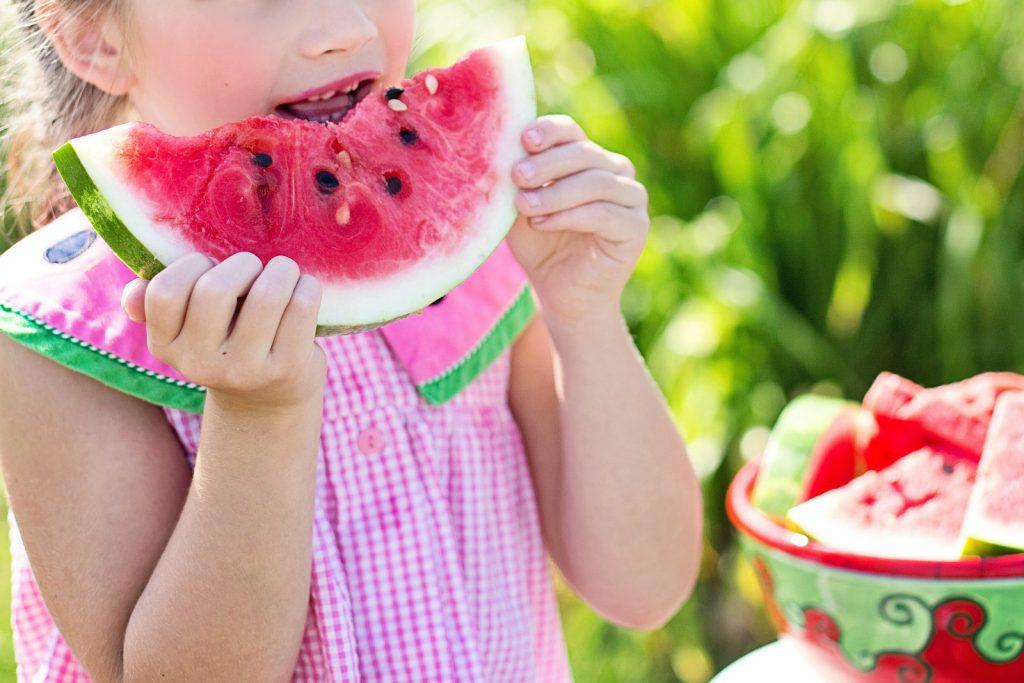 girl eating watermelon, simple summer activities